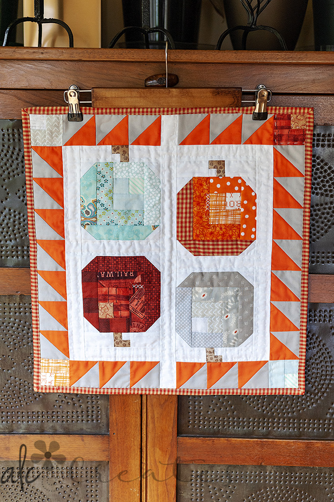 Log Cabin Pumpkins mini quilt by ALC Creates